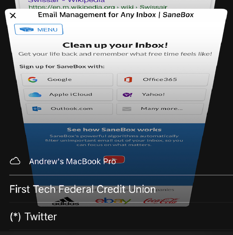 Safari window on an iPhone featuring the tabs open on a user's MacBook Pro